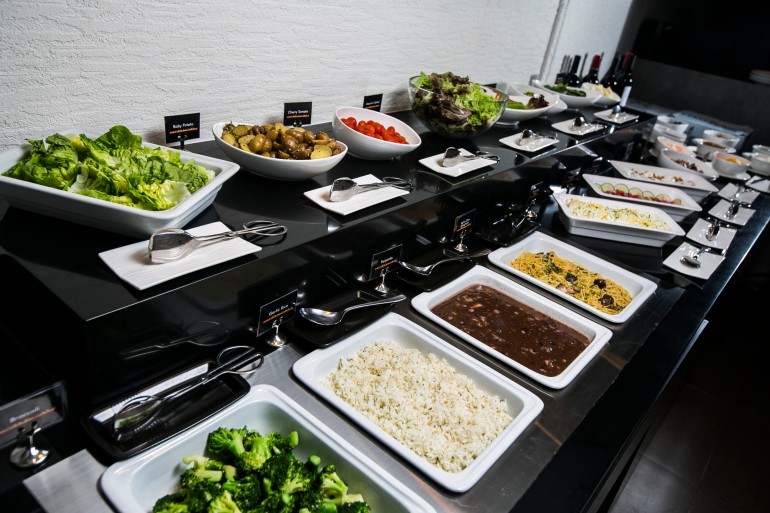 The buffet line comprises yummy offerings that accompany the meats