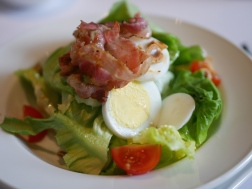 Butter Lettuce Salad Served with Pancetta, Hazelnut and Egg
