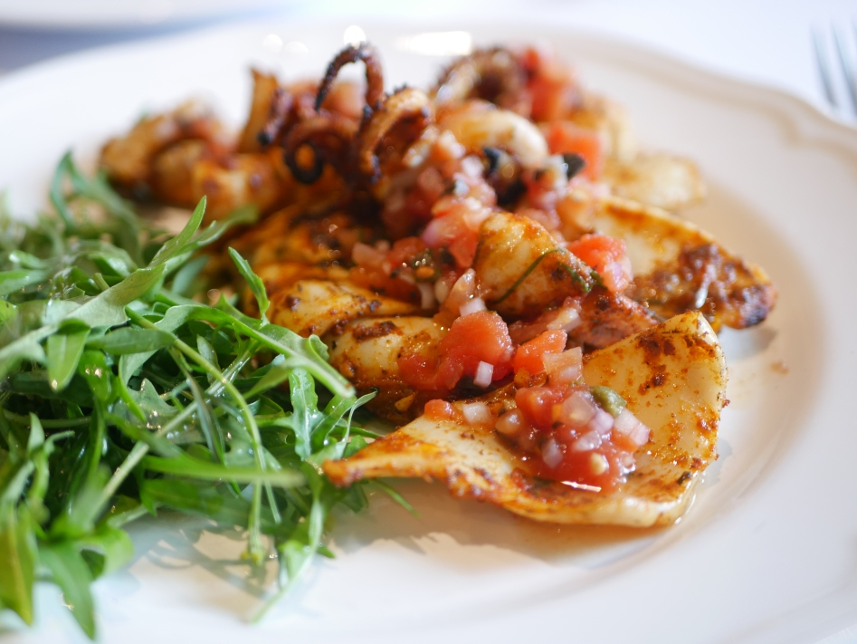 Grilled Calamari ($25) Served with Tomato, Capers, and Kalamata Olives