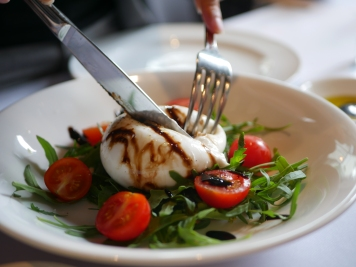 Puglia Burrata ($26) Served with Organic Italian Tomato and Rock Lettuce