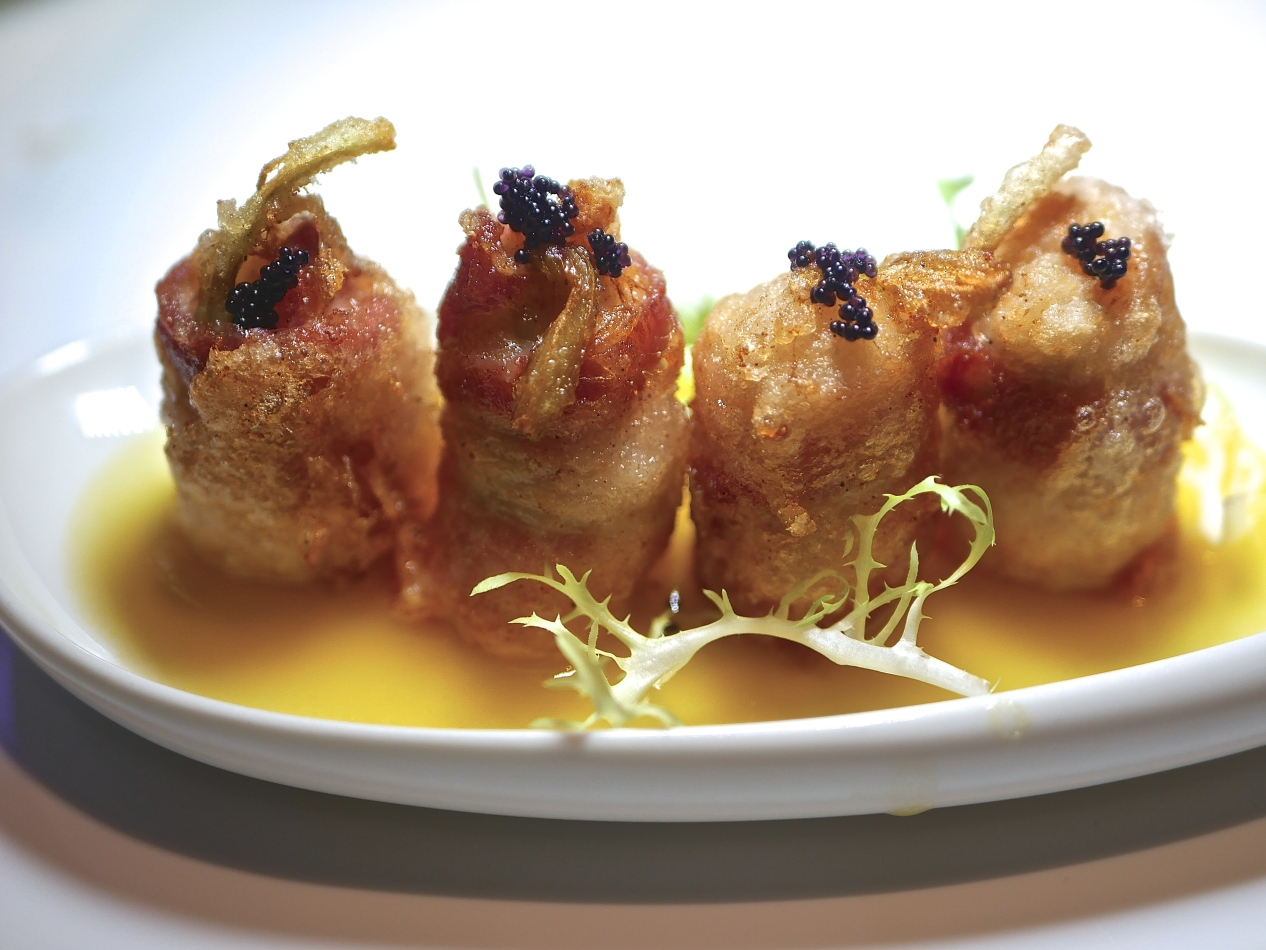 Steamed Bacon Roll Served With Golden Seafood Sauce