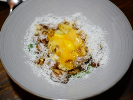 Smoked potato & egg yolk raviolo, pickled girroles & hazelnuts ($28)
