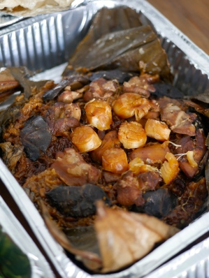 Steamed glutinous rice in lotus leaf with dried shrimp & scallop, chicken morsels and spring mushrooms